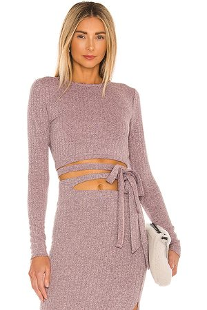 Lovers + Friends Cailey Wrap Top in - Mauve. Size L (also in M, S, XL, XS, XXS).