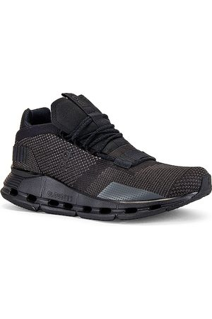 On Running Cloudnova in - Black. Size 10 (also in 10.5, 11, 12, 13, 8, 8.5, 9, 9.5).