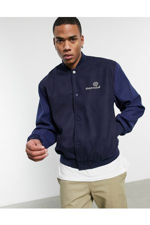 ASOS ASOS Daysocial oversized varsity jacket in navy with contrast blue sleeves