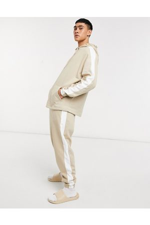 ASOS Oversized tracksuit in beige with white side stripe