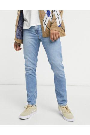 ASOS Stretch slim jeans in light wash blue