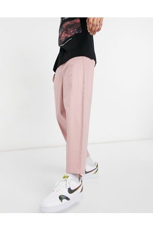 ASOS Oversized tapered chino trousers in pink