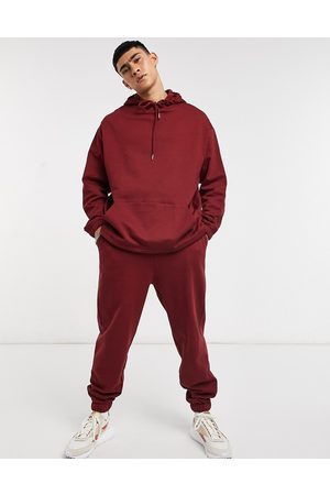 ASOS Organic tracksuit with oversized hoodie & oversized joggers in burgundy-Red