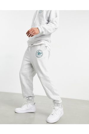 ASOS Co-ord oversized joggers with Roman numerals logo print-White