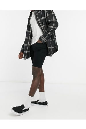 ASOS Homem Calções - Skinny denim shorts in black