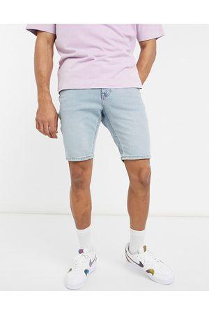 ASOS Homem Calções - Skinny denim shorts in vintage light blue tint