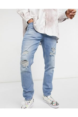 ASOS Stretch slim jeans in vintage mid wash with heavy rips-Blue