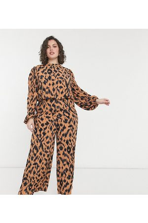 Never Fully Dressed Plus High neck puff sleeve jumpsuit in brown animal print