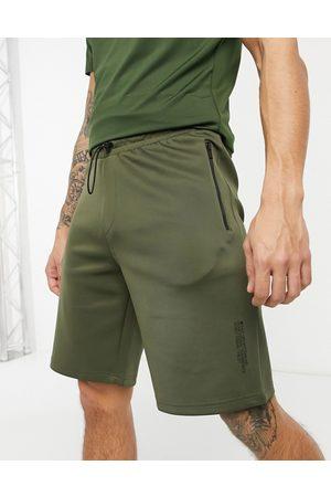 HIIT Training tech shorts in khaki green