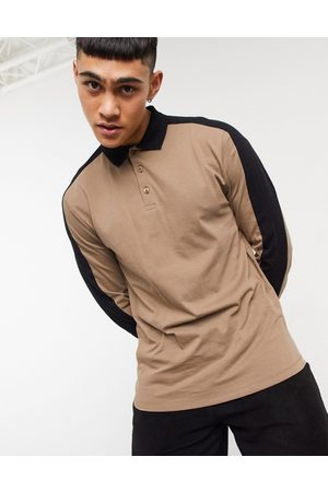ASOS Organic long sleeve polo shirt with contrast shoulder panels in brown