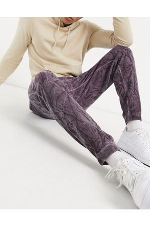 ASOS DESIGN Homem Joggers - Co-ord tapered joggers in purple crinkle wash