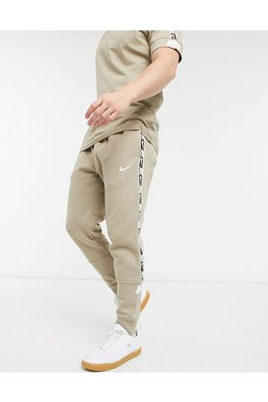 Nike Repeat Pack taping cuffed joggers in stone-Green