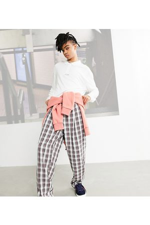 COLLUSION Balloon leg trousers in brown check