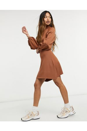 ASOS Knitted fit and flare dress with pleat sleeve detail in camel-Stone