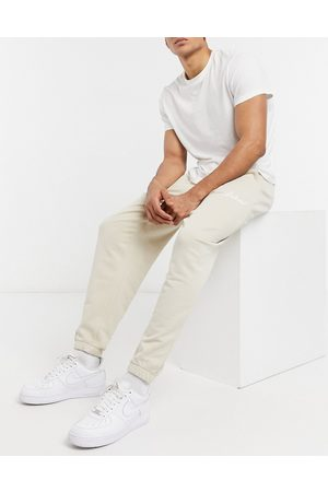 ASOS Co-ord relaxed joggers in beige with script print