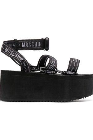 Moschino Senhora Sandálias - Logo-strap flatform sandals