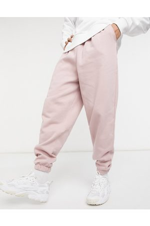 ASOS Oversized joggers with thin waistband in washed pink