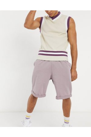 ASOS Oversized jersey shorts in washed purple with rolled hem