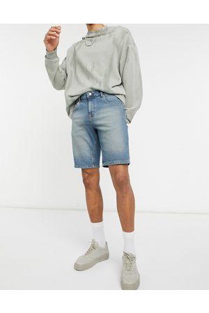 ASOS Slim denim shorts in tinted dark wash blue