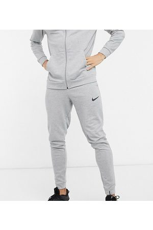 Nike Tall Dry tapered joggers in grey