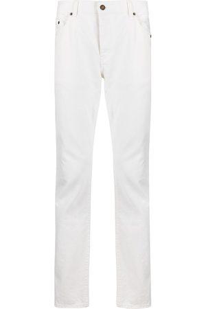 Saint Laurent Stonewashed slim-fit jeans
