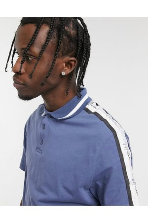 ASOS Skinny polo shirt in blue with sleeve taping