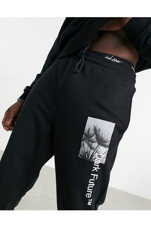ASOS Dark Future Co-ord oversized joggers in black with graphic and logo prints