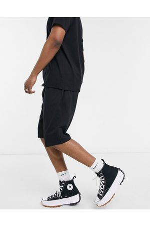 ASOS DESIGN Lightweight jersey shorts with drop crotch in black