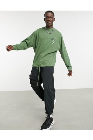 ASOS Dark Future Oversized long sleeve t-shirt with back print and drawcord in green