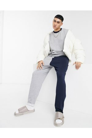 ASOS DESIGN Co-ord oversized joggers in grey marl & navy colour block & rolled hem
