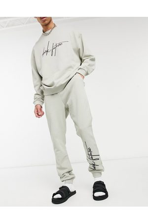 ASOS Dark Future Co-ord oversized joggers with script logo in ice grey