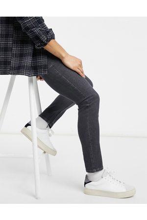 Burton Menswear Super skinny jeans in washed black