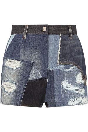 Dolce & Gabbana Distressed patchwork denim shorts