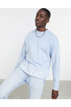 ASOS Oversized long sleeve t-shirt with drawcord hem in blue wash