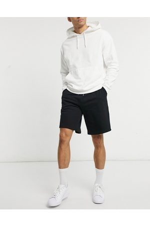 ASOS DESIGN Oversized jersey shorts in black