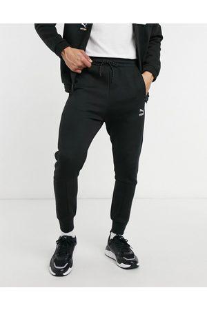 PUMA International logo track pants in black
