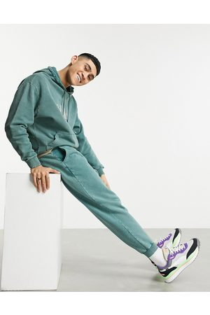 ASOS Co-ord oversized joggers in green acid wash