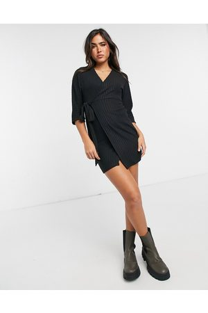River Island Long sleeve belted cosy mini dress in black