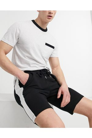 ASOS Jersey skinny shorts with side stripe in black