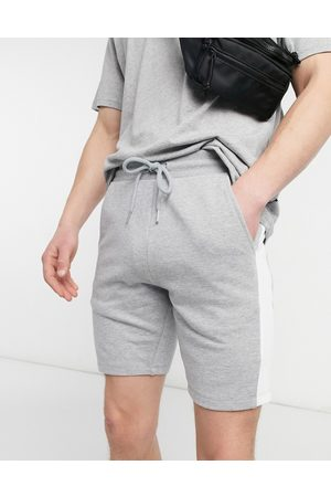 ASOS DESIGN Jersey skinny shorts with side stripe in grey marl