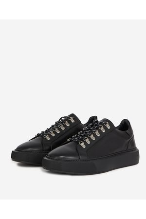 The Kooples Flat black sneakers in leather with eyelets