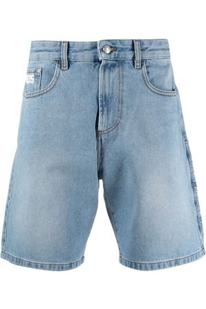 GCDS Wide-leg denim shorts