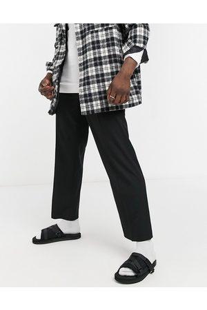 Topman Homem Calças à Boca-de-sino - Wide leg trousers in black