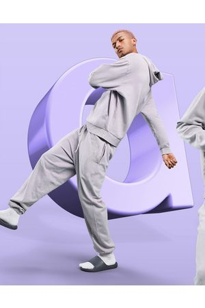 ASOS Relaxed jogger in lilac wash with logo-Purple