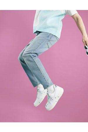 ASOS Homem Tapered - Tapered jeans in light wash blue