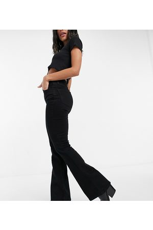 Reclaimed Vintage Inspired 79' super stretch flare jean in clean black