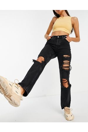 ASOS Organic mid rise '90s' straight leg jeans in washed black with extreme rips