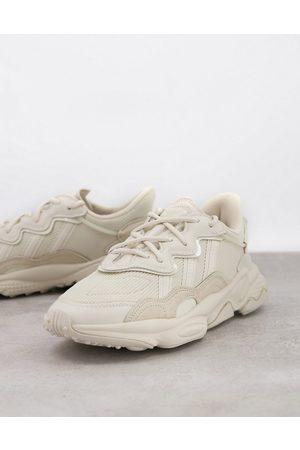 adidas Ozweego trainers in beige-White