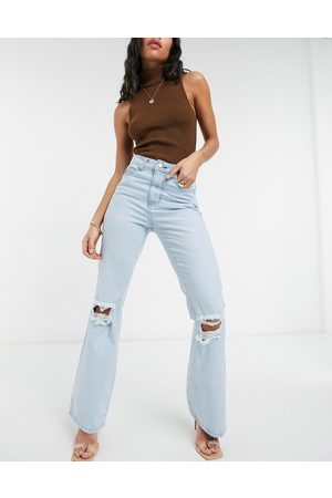 Femme Luxe High waist flares with busted knee in light blue