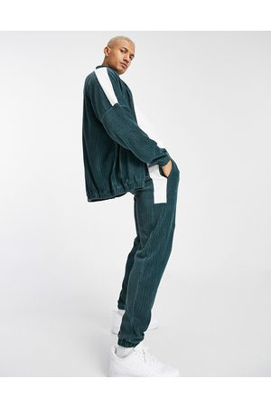 ASOS Co-ord tapered joggers in velour cord with colour blocking-Green